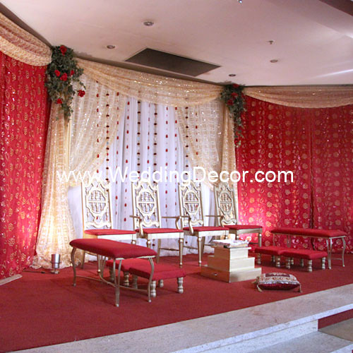 A wedding mandap in red gold and ivory To see additional wedding decor