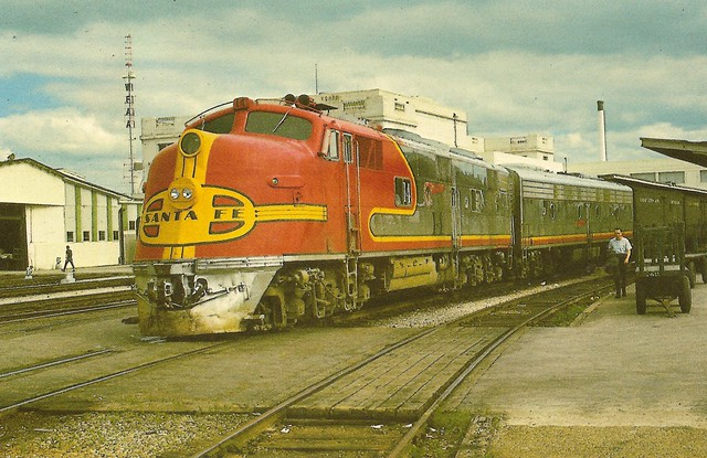 """ATSF0008 Train No. 12 """"The Chicagoan"""" was scheduled to leave Dallas at 8:30 pm and arrive at Chicago the next day at 8:00 pm. In the lead is E6 No. 14 built in 1940. Followed by 80A an E8B on this 26th day of April 1966 in Dallas, Texas. (Lt.Col. D.A. Woo"""