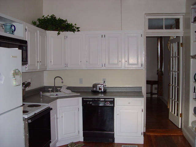 Inexpensive kitchen makeover transforming cabinets with for Inexpensive kitchen cabinet makeovers
