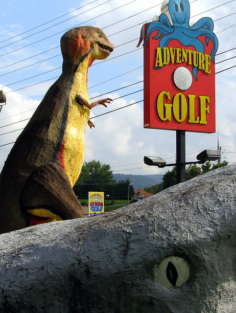 Adventure Golf: Sign with T-Rex and Jaws