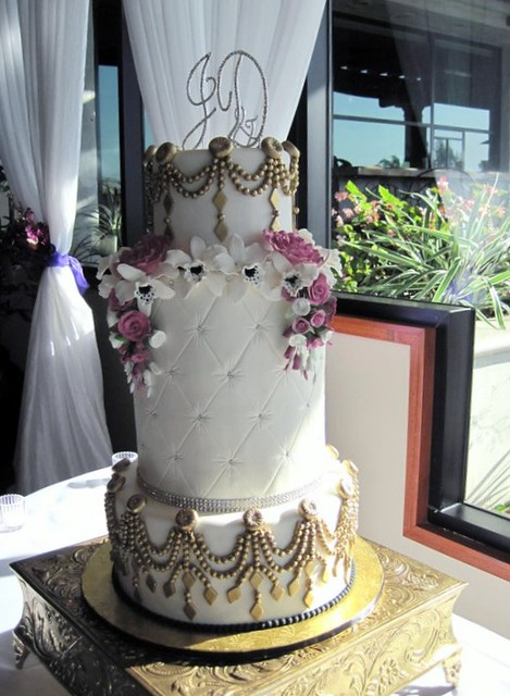 Three tier all fondant wedding cake Gumpaste flowers and fondant pearl