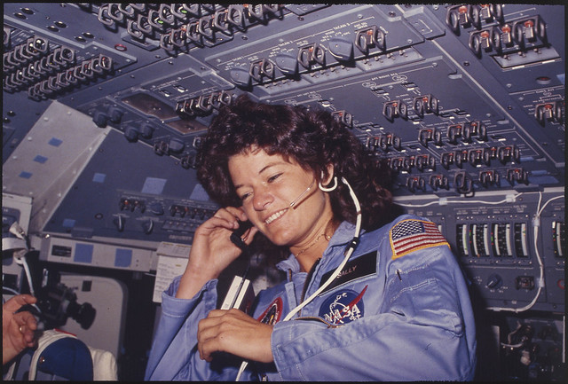 [Sally Ride] America's first woman astronaut communitcates with ground controllers from the flight deck during the six day mission of the Challenger.
