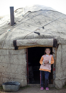 Girl At The Entrance Of Her Yurt, Jaman Echki Jailoo Village, Song Kol Lake Area, Kyrgyzstan