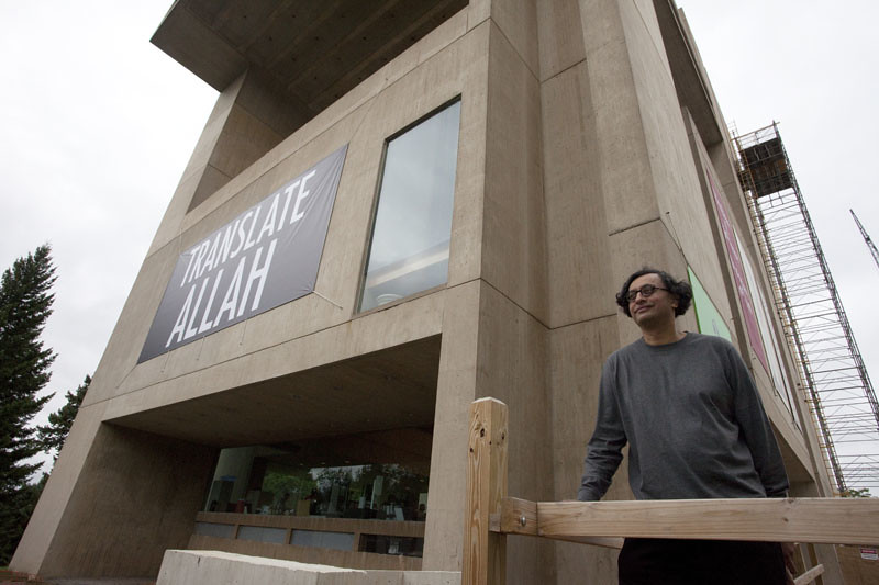 Department of Art Chair Iftikhar Dadi stands outside the Herbert F. Johnson Museum of Art.