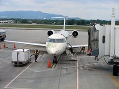 aerospace engineering, airline, aviation, airliner, airplane, airport, vehicle, jet bridge, infrastructure, tarmac, aircraft engine,