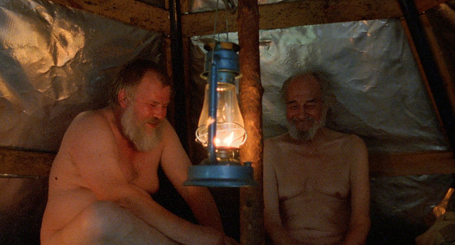 Men in the sauna: without clothes and thick armors.