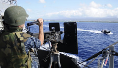 PACIFIC OCEAN (March 30, 2011) Gunner's Mate 2nd Class David Manis simulates firing a crew-served weapon aboard the guided-missile destroyer USS Chafee (DDG 90) during a small boat attack exercise. Hawaii-based Surface Navy and other combatant units are participating in Koa Kai 11-2, an integrated training event with the goal of attaining deployment certificates and training. (U.S. Navy photo by Mass Communication Specialist 2nd Class (SW) Mark Logico)