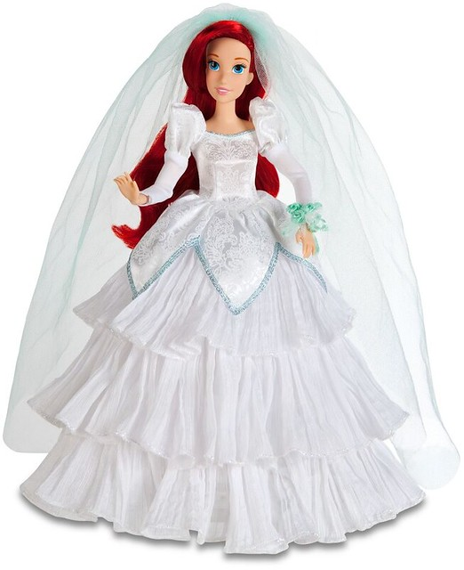She looks beautiful in her sparkly wedding gown and flowing red hair