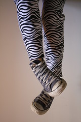 arm(0.0), brown(0.0), zebra(0.0), trousers(0.0), pattern(1.0), footwear(1.0), clothing(1.0), leggings(1.0), limb(1.0), tights(1.0),
