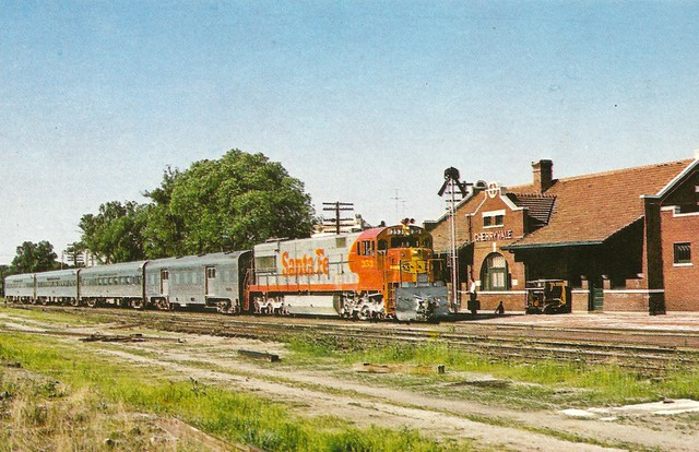 """ATSF0005 Santa Fe's lightweight streamline train arrives Cherryvale, Kansas in 1968. """"The Tulsan"""" trains 211 and 212 ran between Kansas City and Tulsa on a daylight schedule. Locomotive 353 is one of General Electric U28CG units built for passenger servic"""
