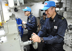 PACIFIC OCEAN (June 26, 2011) Ensigns Haruhisa Kosuge, left, and Shohei Yamaguchi, assigned to the Japan Maritime Self-Defense Force, test the back-up steering of the guided-missile frigate USS McClusky (FFG 41) during a joint forces passing exercise.(U.S. Navy photo by Mass Communication Specialist 3rd Class Dominique Pinero/Released)