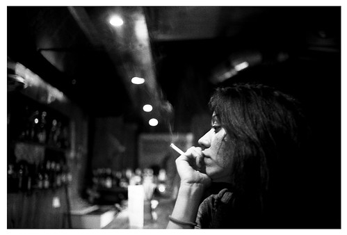 girl smoking in bar
