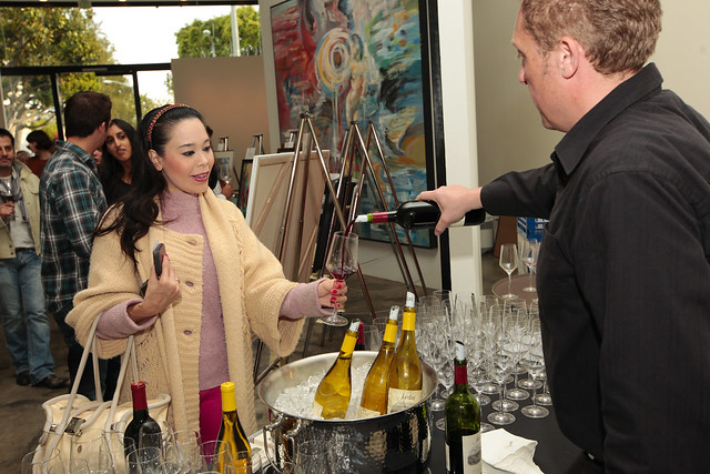 Guests sample Jordan Cabernet Sauvignon and Chardonnay at Jordan Winery's 4 on 4 Art Competition at Hadid Gallery on April 11