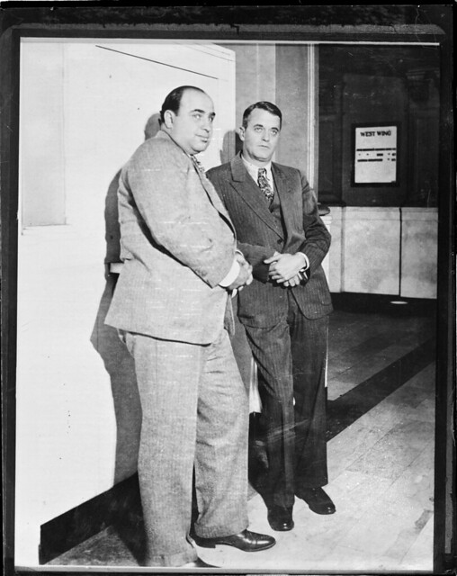al capone and attorney michael ahern held for evading