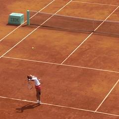 floor(0.0), baseball field(0.0), sport venue(1.0), soft tennis(1.0), individual sports(1.0), tennis court(1.0), tennis(1.0), sports(1.0), tennis player(1.0), net(1.0), ball game(1.0), racquet sport(1.0), flooring(1.0),
