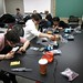 <p>students laboring on sensor units</p>