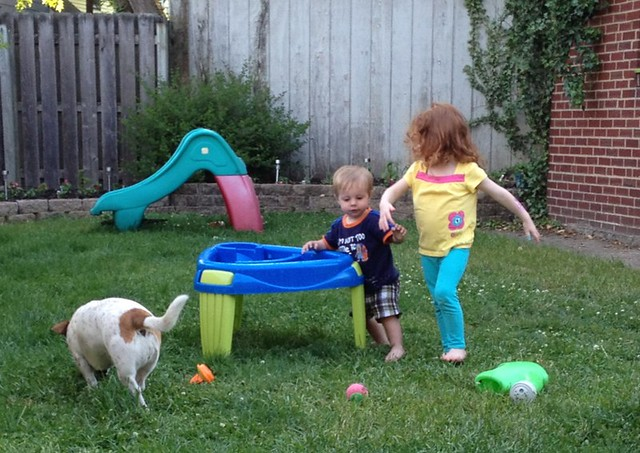 HOURS later and the water table is still entertaining all 3of them.