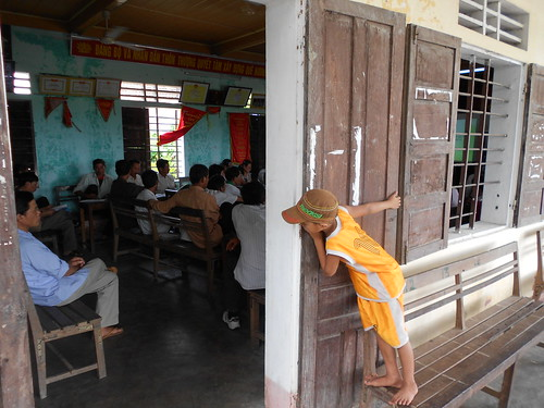 A Boy Sneaks a Glance at the Climate Change Training in Quang Ninh