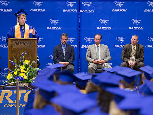 Outstanding Graduate Jordan Klima addresses his fellow classmates Friday during Barton's 44th commencement ceremony.