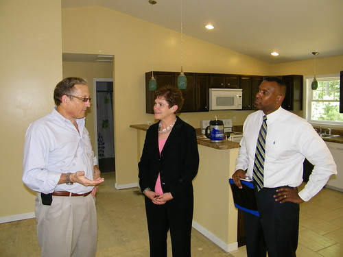 Hanover Habitat Executive Director Tim Bowring, Deputy Secretary Krysta Harden, and Rural Development State Director Basil Gooden tour energy efficient homes constructed through a new partnership between USDA and The Hanover County Chapter of Habitat for Humanity.