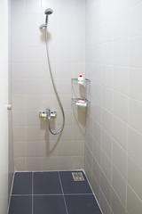 toilet(0.0), urinal(0.0), bidet(0.0), floor(1.0), room(1.0), plumbing fixture(1.0), shower(1.0), tile(1.0), bathroom(1.0), flooring(1.0),
