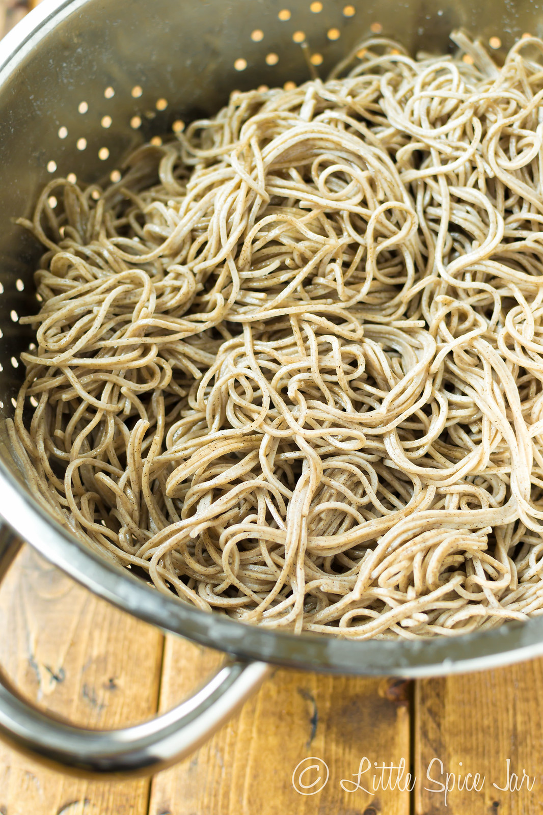 cooked soba noodles in colander