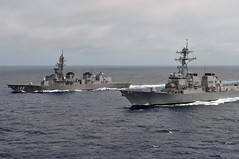 In this file photo, guided-missile destroyer USS Lassen (DDG 82) steams in formation with Japan Maritime Self-Defense Force ship JS Harasume (DD 102) during a June 2011 passing exercise in the Pacific Ocean. (U.S. Navy photo)