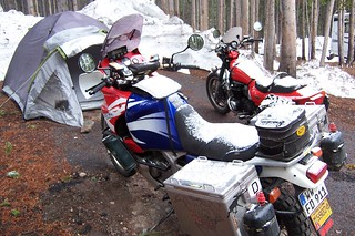 Snow on our motorcycles in Yellowstone