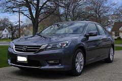 automobile(1.0), automotive exterior(1.0), executive car(1.0), wheel(1.0), vehicle(1.0), honda(1.0), bumper(1.0), sedan(1.0), land vehicle(1.0), luxury vehicle(1.0), honda accord(1.0),