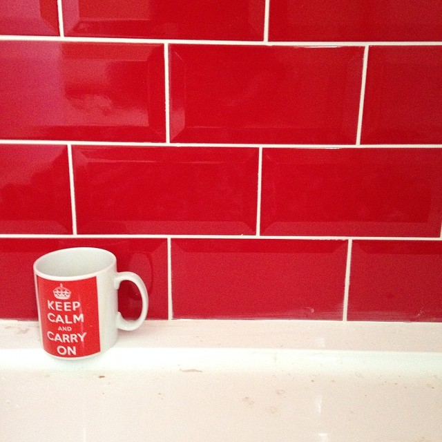 Tiler has finished the main bathroom. Swear I didn't give him this mug deliberately! #capturingcolour #red #bathroom