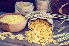 Uncooked Italian pasta Farfalle, Elbow macaroni an…