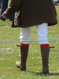 Woman in wellies at a festival