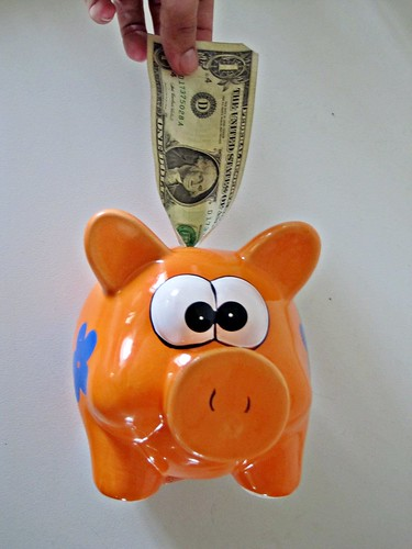Dollar in Piggy Bank by Images_of_Money, on Flickr