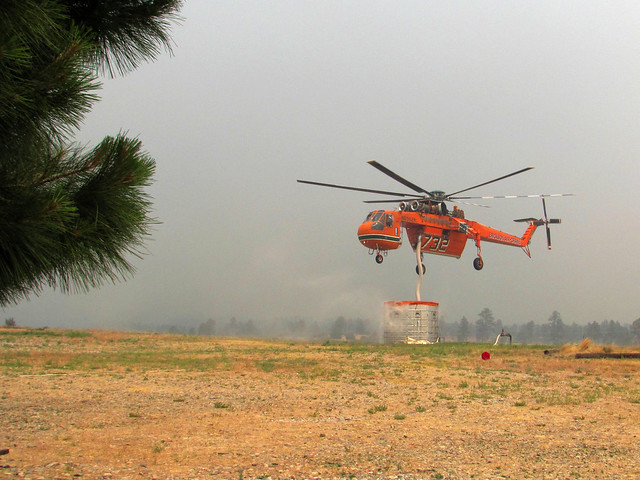 A Sikorsky heavy-lift helicopter, known as a Skycrane, engaged in fighting the Las Conchas Fire fills up with water at one of the tanks located at Los Alamos National Laboratory.  Photo by James Rickman