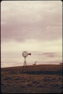 Windmill on the rolling ranch lands near Powder River Wyoming, 06/1973