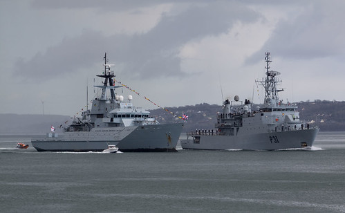 L.E. Eithne passes HMS Mersey during fleet review.