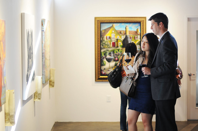 Guests admire the exhibition at Jordan Winery's 4 on 4 Dallas Art Competition Hosted by D Magazine at Rising Gallery