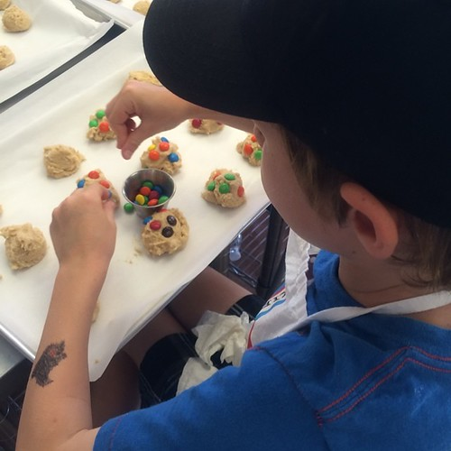 My son's favorite part - adding the m&ms @cookie_doughjo #thecookiedoughjoaz