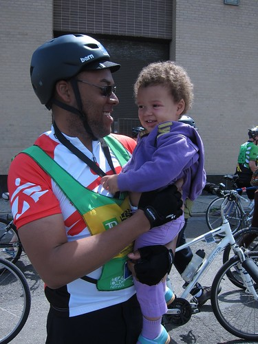 Z cheers her daddy on--Partway through the 5 Boro Bike Tour, Masheka stops for a goodluck hug from Z.