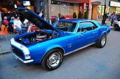 auto show(0.0), convertible(0.0), automobile(1.0), automotive exterior(1.0), wheel(1.0), vehicle(1.0), pony car(1.0), antique car(1.0), land vehicle(1.0), chevrolet camaro(1.0), muscle car(1.0), sports car(1.0),
