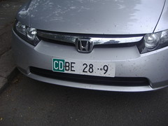 wheel(0.0), rim(0.0), honda civic(0.0), automobile(1.0), automotive exterior(1.0), vehicle(1.0), honda(1.0), grille(1.0), bumper(1.0), honda civic hybrid(1.0), land vehicle(1.0), vehicle registration plate(1.0),