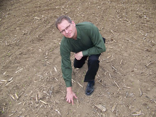 Illinois field office director Brad Schwab examines a field of early planted corn in central Illinois. (NASS)