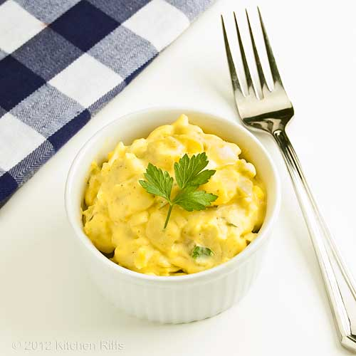 Mustard Potato Salad in White Ramekin with Parsley Garnish, White Background