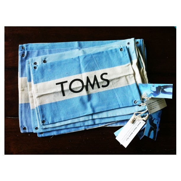 Friends who bring you bunches of TOMS flags are good friends, indeed! | who's up for a TOMS Pouch Sale? | $23 includes US shipping | your pouch will measure 5x7 or larger. | leave your paypal addy to claim one {or three!} | THANK YOU for supporting my fam