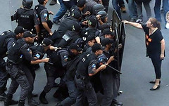 police(1.0), official(1.0), riot(1.0), police officer(1.0), protest(1.0), person(1.0),