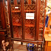 Ornate fabric lined glass display cabinet