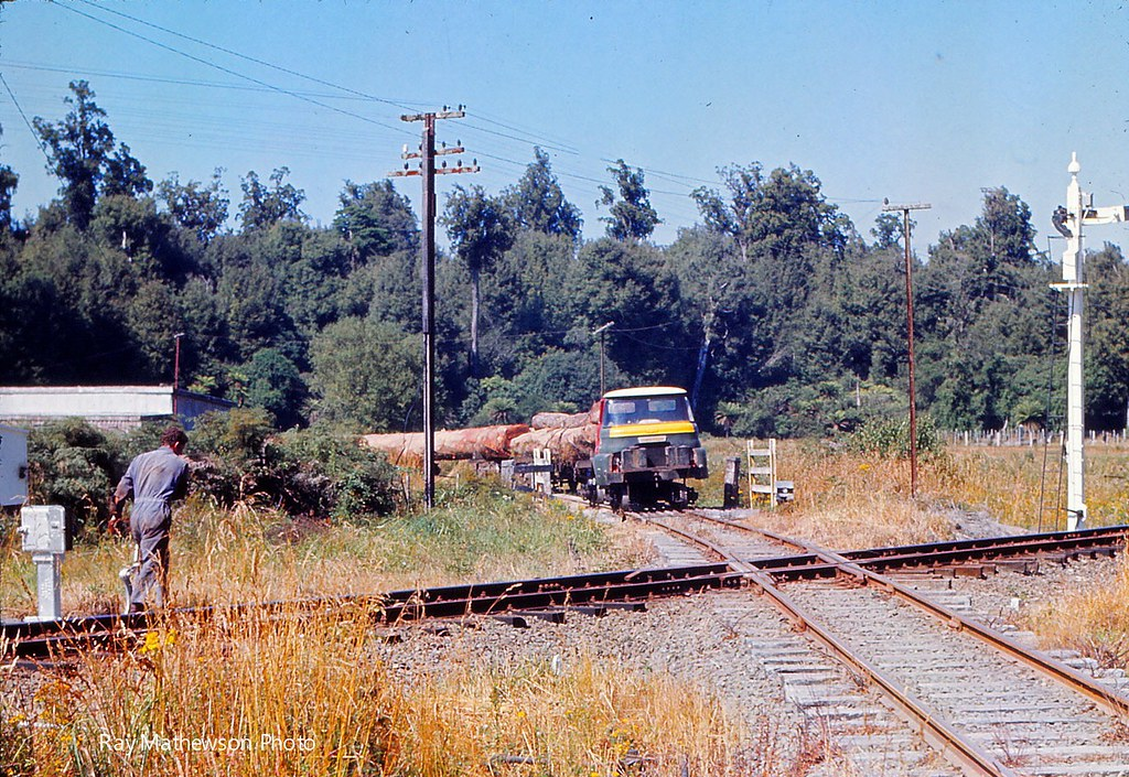 Mr Knowles returning to the bush tram after getting clearance from the NZR to cross Jan 1974