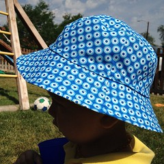 The blue side of the bucket hat.