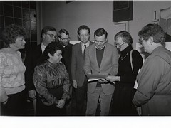 Mayor Raymond L. Flynn with Councilor Thomas M. Menino (back row second from left) and State Representative John McDonough (back row fourth from left) with group of unidentified individuals