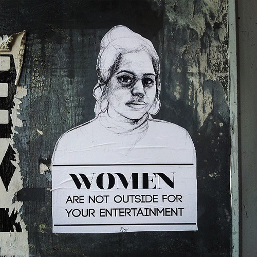 "Wheatpasted image says ""women are not outside for your entertainment"""